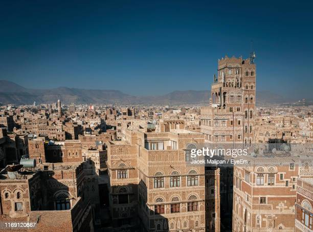buildings in city against clear sky - sanaa stock pictures, royalty-free photos & images