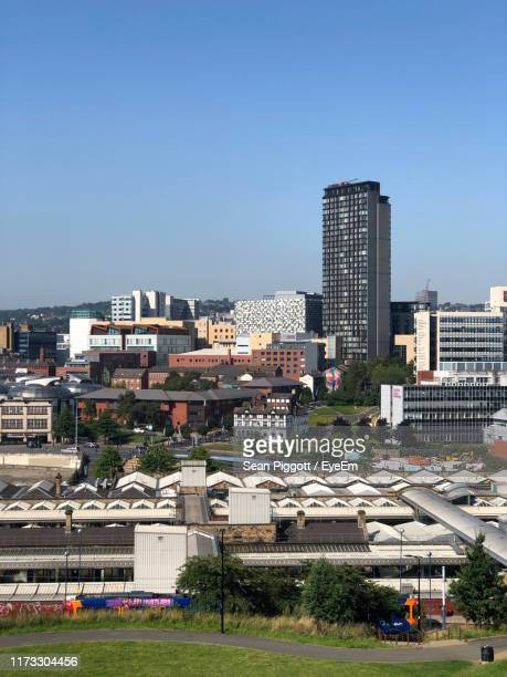 buildings in city against clear sky - sheffield stock pictures, royalty-free photos & images