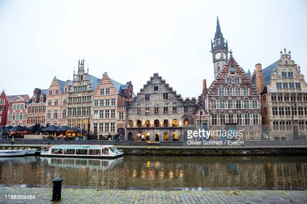 buildings in city against clear sky - brussels capital region stock pictures, royalty-free photos & images