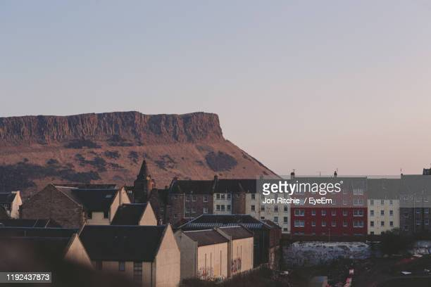 buildings in city against clear sky - edinburgh stock pictures, royalty-free photos & images