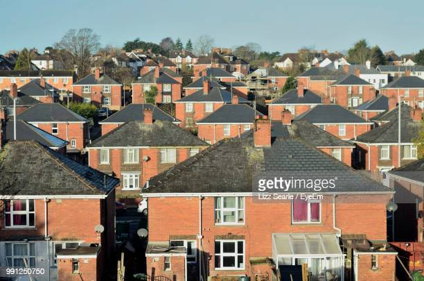 buildings in city against clear sky - exeter england stock pictures, royalty-free photos & images