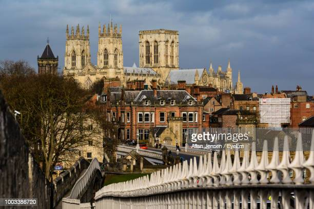 buildings in city against cloudy sky - york yorkshire stock pictures, royalty-free photos & images