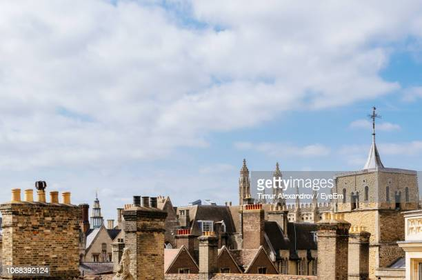 buildings in city against cloudy sky - cambridge stock pictures, royalty-free photos & images
