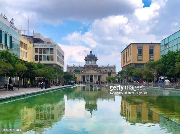 buildings in city against cloudy sky - guadalajara mexico stock pictures, royalty-free photos & images