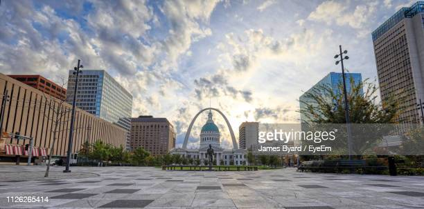 buildings in city against cloudy sky - st. louis missouri stock pictures, royalty-free photos & images