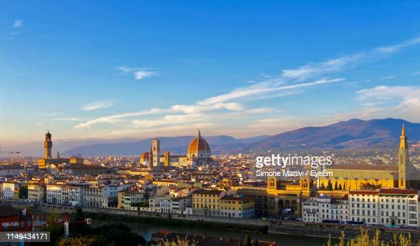 buildings in city against cloudy sky - duomo santa maria del fiore stock pictures, royalty-free photos & images