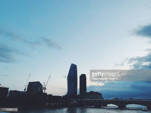 buildings in city against cloudy sky - data topuria stock pictures, royalty-free photos & images