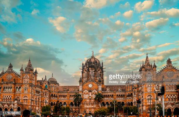 buildings in city against cloudy sky - mumbai stock pictures, royalty-free photos & images