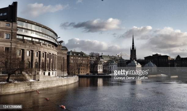 buildings in city against cloudy sky - politics and government stock pictures, royalty-free photos & images