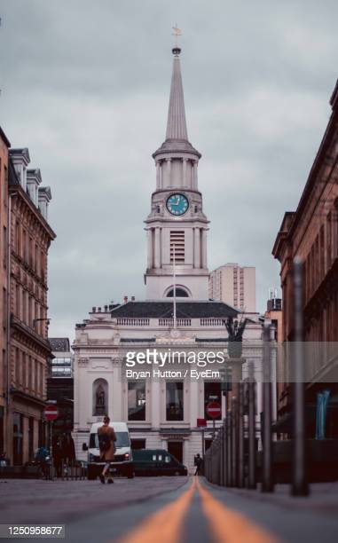 buildings in city against cloudy sky - old glasgow stock pictures, royalty-free photos & images