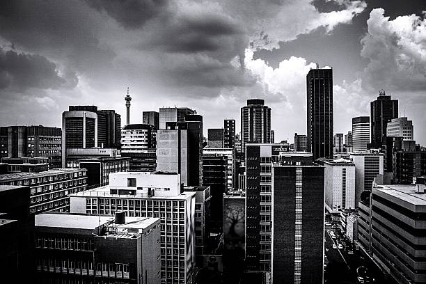 buildings in city against cloudy sky picture