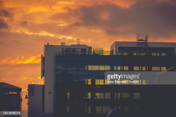 buildings in city against dramatic sky during sunset - leinster province stock pictures, royalty-free photos & images