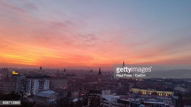 Buildings In City Against Sky During Sunrise
