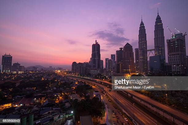 buildings in city against sky during sunrise - shaifulzamri stock pictures, royalty-free photos & images