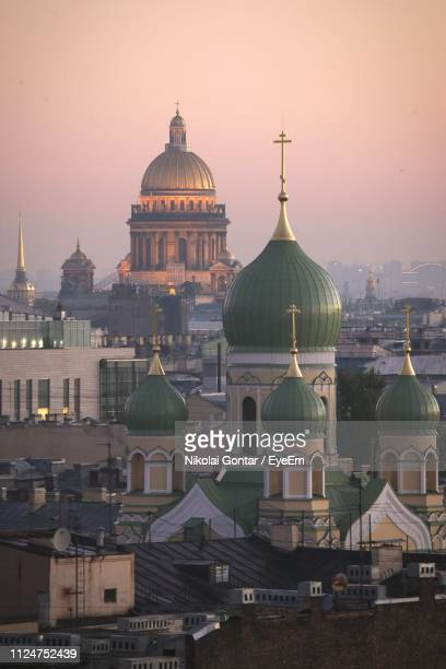 buildings in city against sky during sunset - st. petersburg russia stock pictures, royalty-free photos & images