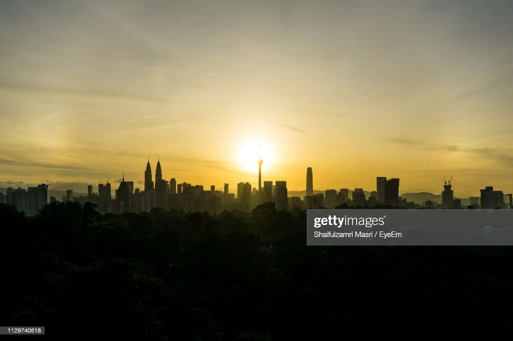 Buildings In City Against Sky During Sunset : Stock Photo