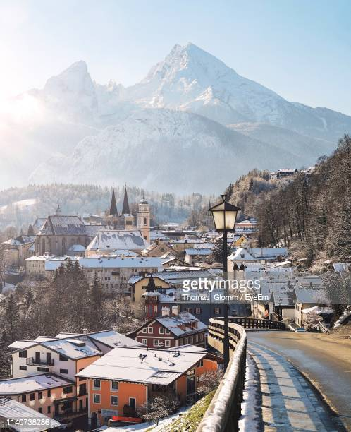buildings in city against sky during winter - berchtesgaden stockfoto's en -beelden