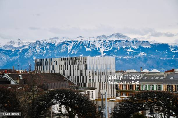 buildings in city against sky during winter - lausanne stock pictures, royalty-free photos & images