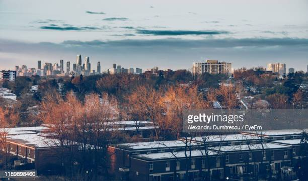 buildings in city against sky during winter - mississauga stock pictures, royalty-free photos & images