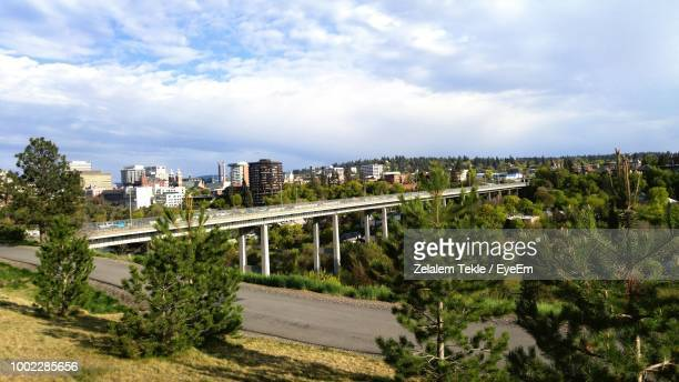 buildings in city against sky - spokane stock pictures, royalty-free photos & images