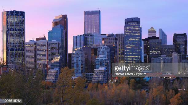 buildings in city against sky - calgary stock pictures, royalty-free photos & images