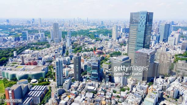 buildings in city against sky - nagoya stock pictures, royalty-free photos & images