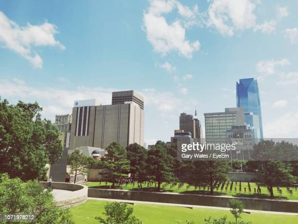 buildings in city against sky - oklahoma city stock pictures, royalty-free photos & images