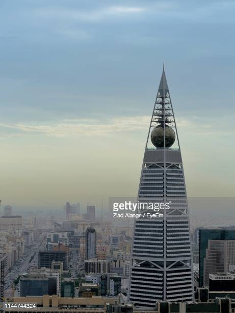 buildings in city against sky - tower stock pictures, royalty-free photos & images