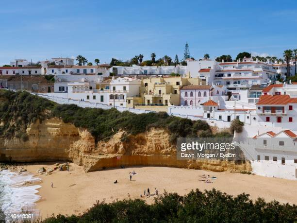 buildings in city against sky - faro district portugal stock pictures, royalty-free photos & images