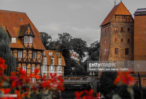 buildings in city against sky - lüneburg stock pictures, royalty-free photos & images