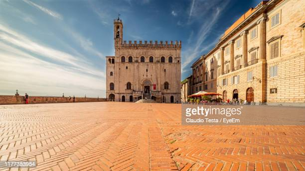 buildings in city against sky - gubbio stock pictures, royalty-free photos & images