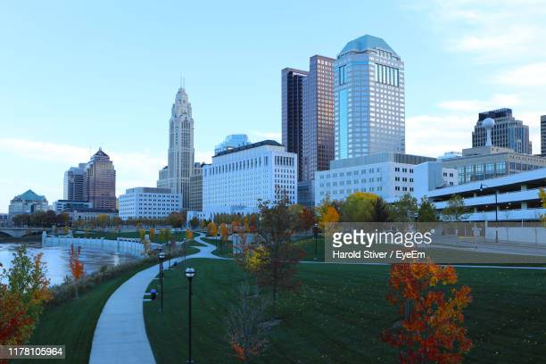 buildings in city against sky - columbus ohio stock pictures, royalty-free photos & images