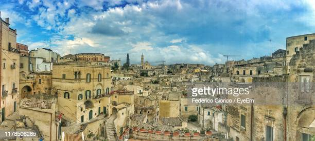 buildings in city against sky - basilicata region stock pictures, royalty-free photos & images