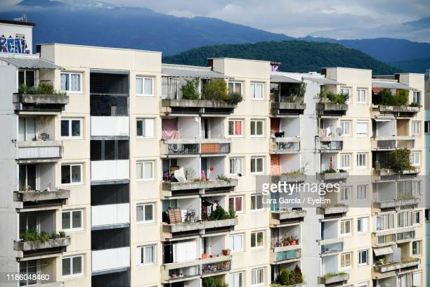buildings in city against sky - grenoble stock pictures, royalty-free photos & images