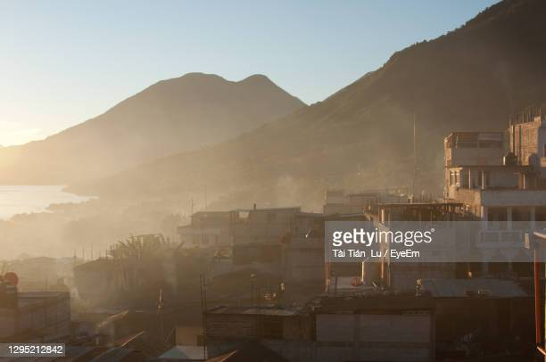 buildings in city against sky - guatemala city stock pictures, royalty-free photos & images