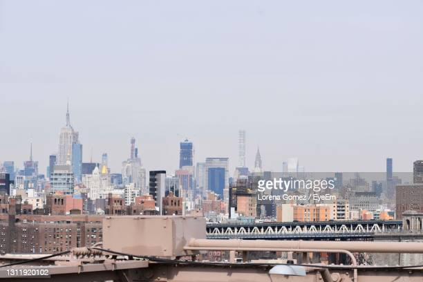 buildings in city against sky - lorena day stock pictures, royalty-free photos & images