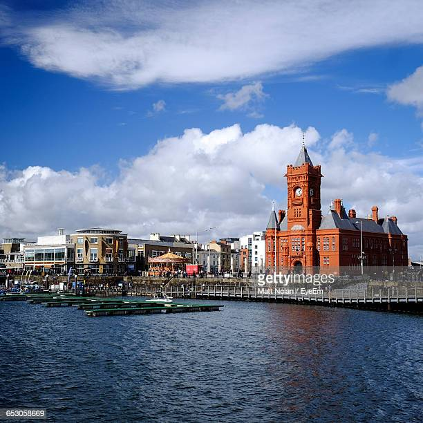 buildings in city against sky - cardiff stock pictures, royalty-free photos & images