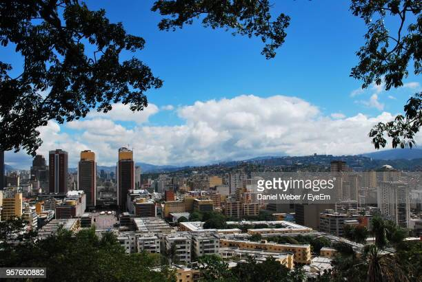 buildings in city against sky - caracas stock pictures, royalty-free photos & images