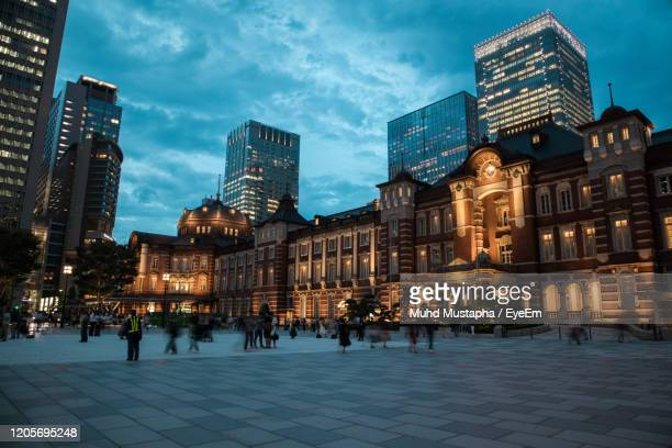 buildings in city at night in tokyo. - courtyard stock pictures, royalty-free photos & images