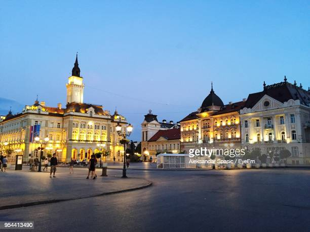 buildings in city at night - serbia stock pictures, royalty-free photos & images