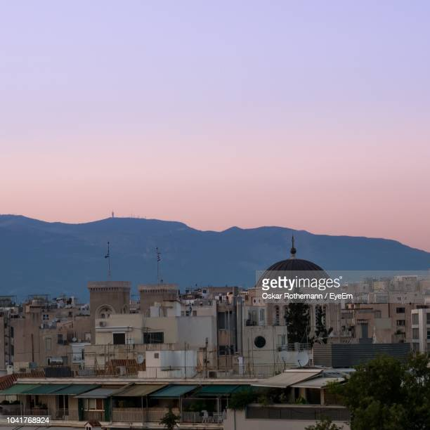 buildings in city at sunset - oskar stock pictures, royalty-free photos & images