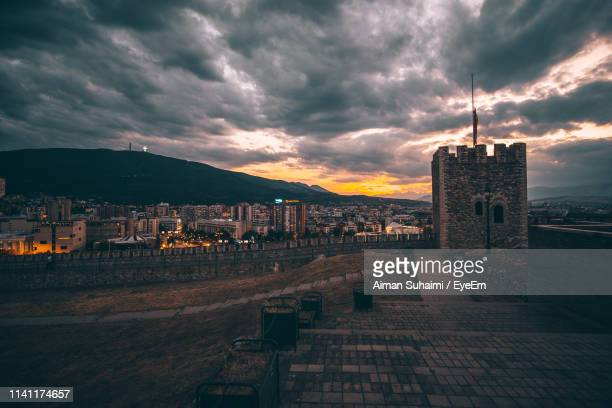 buildings in city at sunset - skopje stock pictures, royalty-free photos & images
