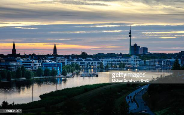 buildings in city at sunset - dortmund city stock pictures, royalty-free photos & images
