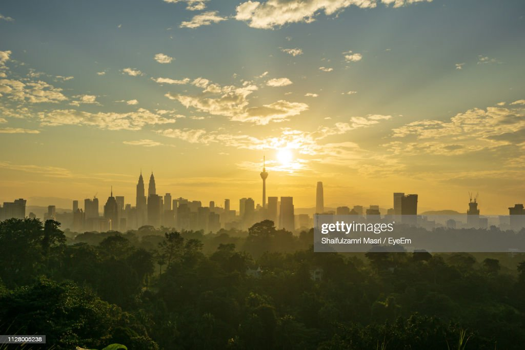 Buildings In City During Sunset : Stock Photo