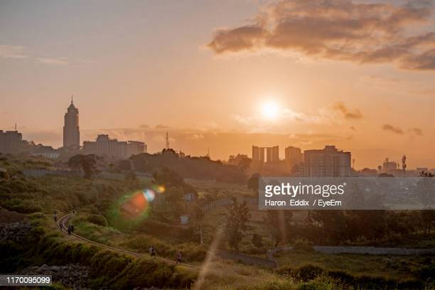 buildings in city during sunset - nairobi stock pictures, royalty-free photos & images