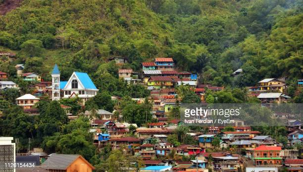 buildings in city - papua province indonesia stock pictures, royalty-free photos & images