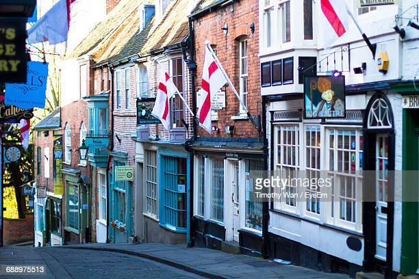 buildings in city - england flag stock photos and pictures