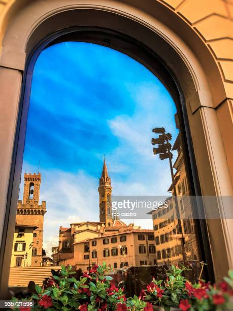 Buildings in Florence Reflected on Window
