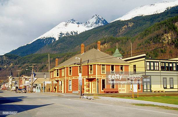 Buildings in front of snowcapped mountain, Klondike Gold Rush National Historic Park, Skagway, Alaska, USA