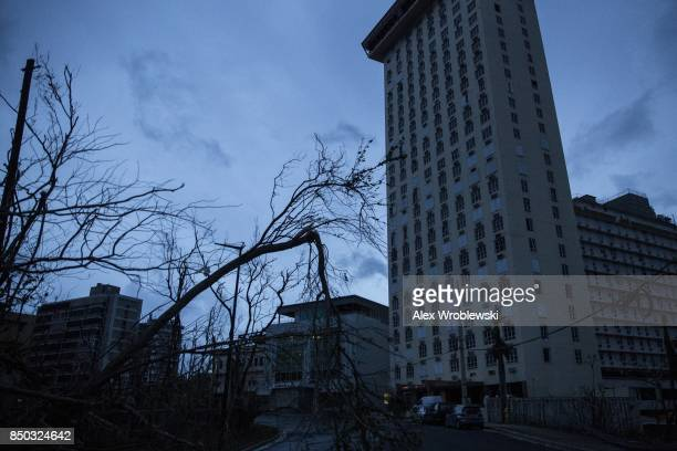Buildings in San Juan are completely dark during a total blackout after Hurricane Maria made landfall September 20 2017 in Puerto Rico Thousands of...